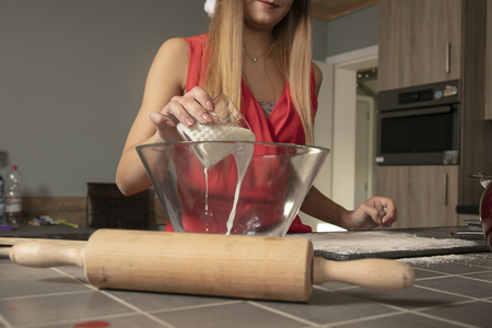girl is preparing a sweets for Christmas, front view Reklamní fotografie