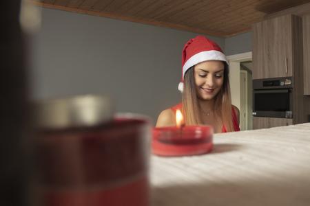 smiling girl is preparing a sweets for Christmas Reklamní fotografie