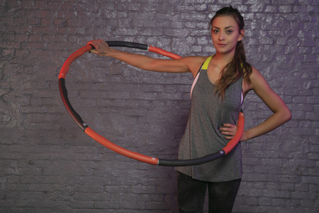 young girl practicing with hula hoop