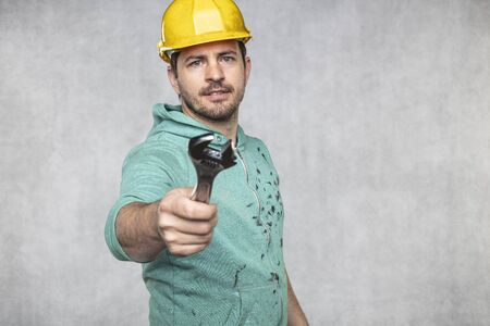 the construction worker holds the key in his hands, the key as a source of inspiration and ingenuity