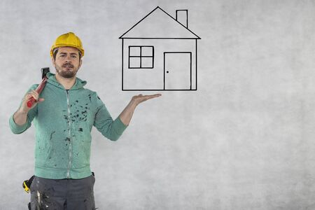 construction worker with a hammer in hand, concept of construction and disassembly, renovation