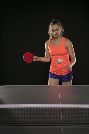 young beautiful athletic girl playing table tennis