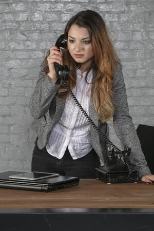 business woman negotiates over the phone, office situation