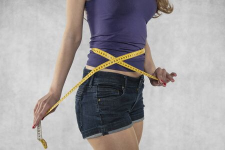 young athletic female silhouette, measure tape