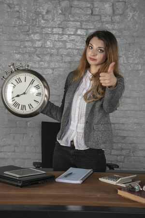 business woman holding a big watch, thumb up Stok Fotoğraf