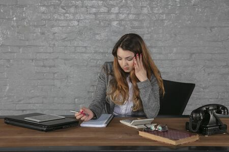young beautiful business woman focused on her work in the office