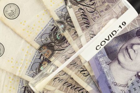 concept of the British pound dependent on the crisis caused by the pandemic coronavirus Stock Photo