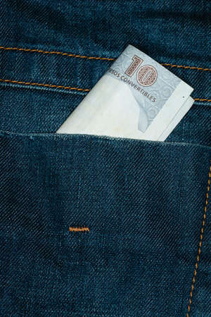 cuba currency in denim pants, people exploitation concept