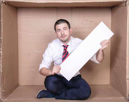 businessman in a cramped office with copy space in his hands 스톡 콘텐츠