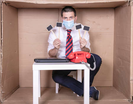 dissatisfied businessman with facial mask holds the placard in his hands, copy space