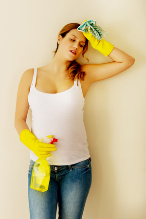 Pregnant woman cleaning at home. Stock Photo