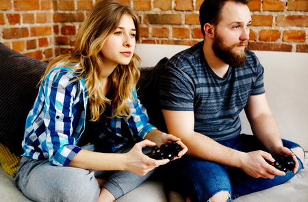 Playing in video games. Stock Photo