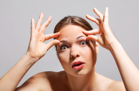 astonishment: Wrinkles on forehead Stock Photo