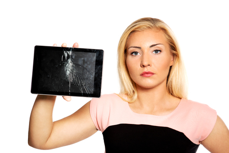 Woman with broken tablet