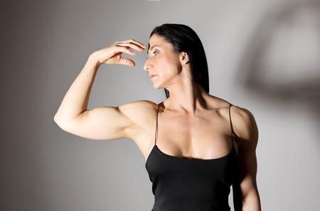 Woman bodybuilder in dress.