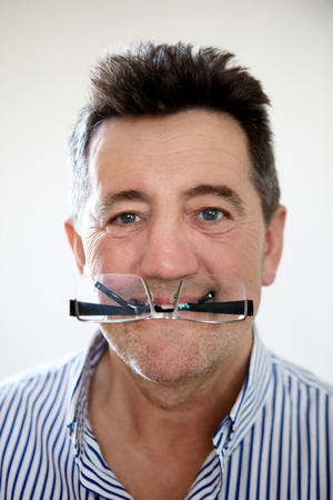 aging face: Senior man fooling around Stock Photo