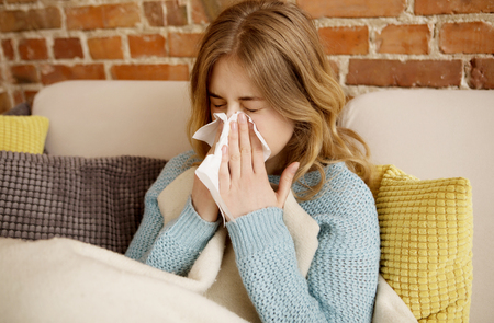 Young woman with cold, flue. Stock Photo