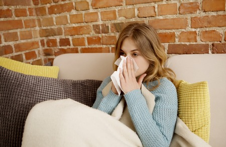 Young woman with cold, flue. 스톡 콘텐츠