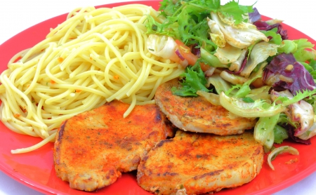 Pork chops with pasta and salad