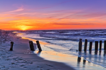 Breakwater during sunset Stock Photo
