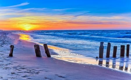 Polish beach at sunset Stock Photo