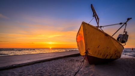 Fishing boat during sunset photo