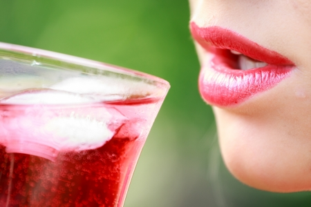 Woman with red lips with a drink