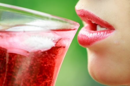 Woman with red lips drinking a cocktail Stock Photo