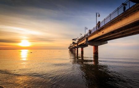 Sunset and pier in Miedzyzdroje Stock Photo