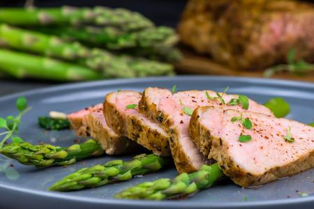 Roasted pork tenderloin and asparagus - close up