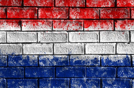 nederland: Netherlands flag painted on old brick wall texture background