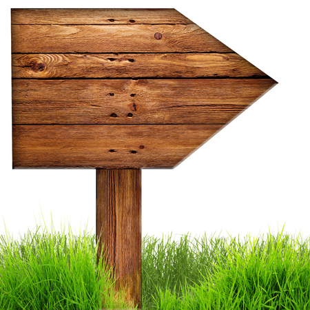 arrow wood: Wood arrow sign with grass isolated on a white. Stock Photo