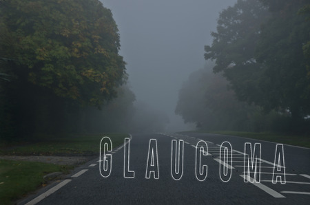 optic nerves: Word glaucoma written on foggy, blurred road, danger autumn road.