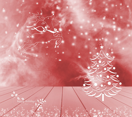 product display: Christmas tree, reindeer and snow on red background. Red empty wooden table ready for your product display montage. Happy holidays.