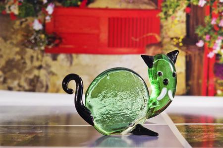 cat goddess: Handmade decorative figure of melted green glass.