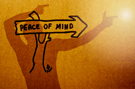 peace of mind: Shadow of a man pointing on light. Peace of mind written on arrow showing bright mark.