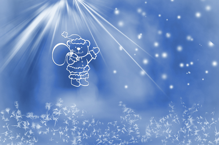 winter wonderland: Winter wonderland. Teddy bear  with bag of presents on snowy blue background. Stock Photo