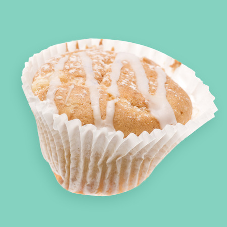 home baked: Home baked tasty cup cake, muffin with frosting on top isolated on green background.