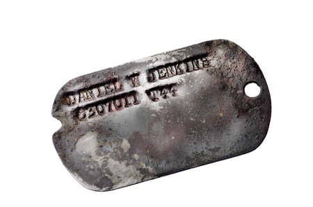 tag: American second war dog tag on black background. Stock Photo