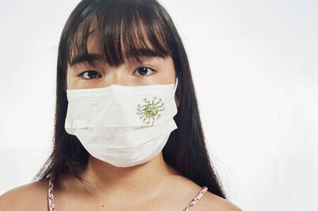 Young japanese girl wearing a mask