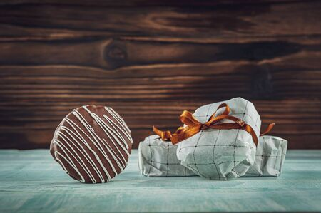 Honey cookie chocolate covered in a gift wrapping - gingerbread Banco de Imagens