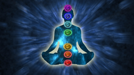 chakras: Man in Lotus position with chakras