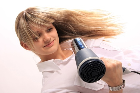young girl with hair dryer photo