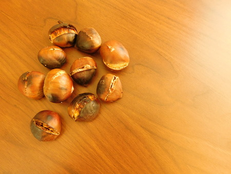 infer: chestnuts on wooden base Stock Photo