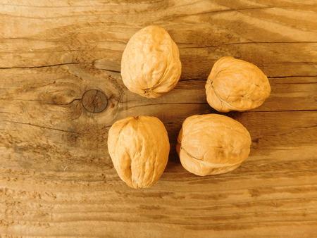 broken back: nuts on wooden base Stock Photo