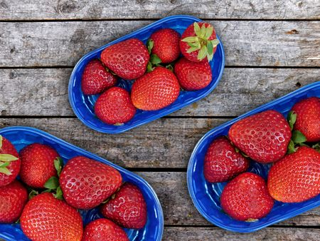 natures: Strawberries on wooden background