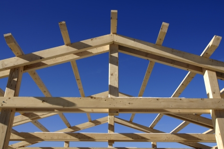 gable home renovation: Wooden roof during the early stages of construction in a sunny day Stock Photo