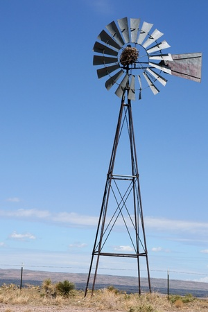 old farm: Wind mill pump in USA Stock Photo