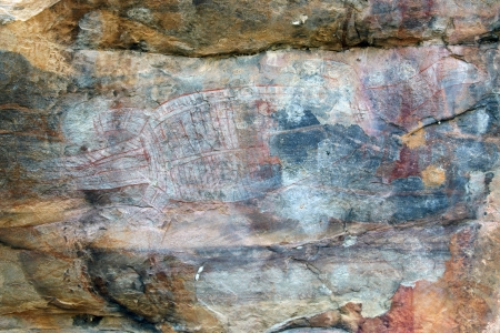 Ancient crocodile rock art in Ubirr, Australia photo