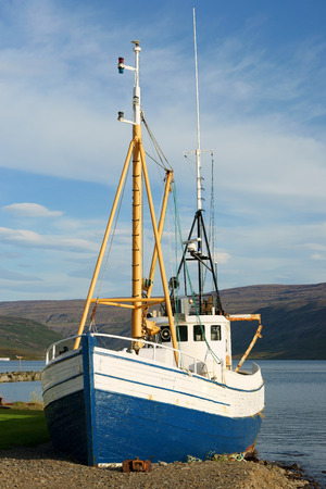 commercial fisheries: Old fishing boat on the shore, Talkanfjords, Iceland